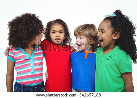Four kids standing together in a line against a white background - stock photo