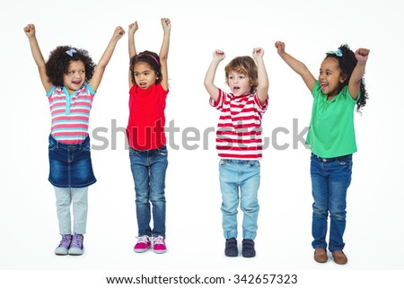 Four kids standing with arms raised in the air against a white background