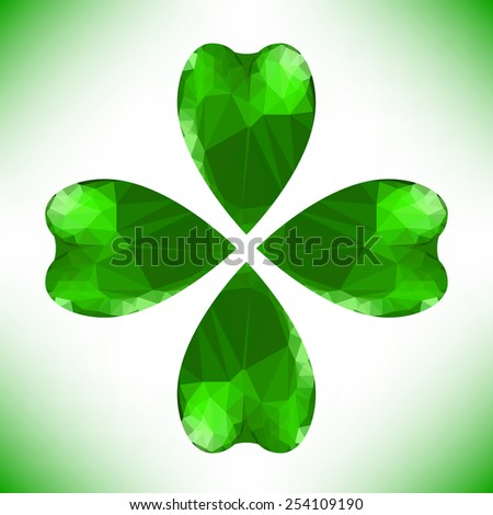 Four- leaf clover - Irish shamrock St Patrick's Day symbol. Useful for your design. Green glass clover isolated on white background.Stylish abstract St. Patrick's day background with leaf clover.