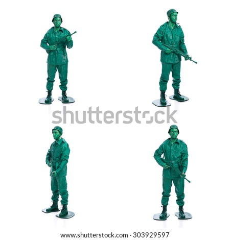 Four man on a green toy soldier costume standing with riffle isolated on white background.