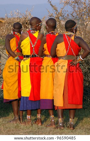 Four Masai Mara women preparing to dance - stock photo