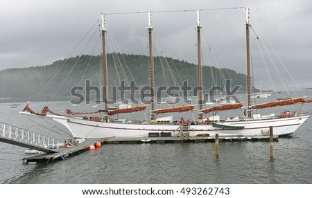 Four masted schooner in a foggy setting