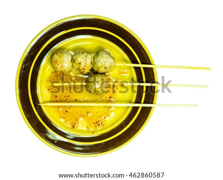 Four meatball on brown dish with isolated background