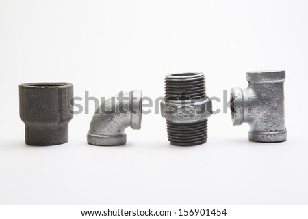 Four metallic fittings isolated over white background  - stock photo