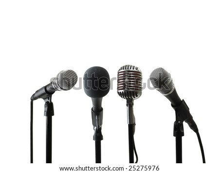Four Microphones on Stands - stock photo