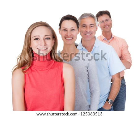 Four middle-aged attractive business associates or friends dressed in casual clothes standing in an oblique line