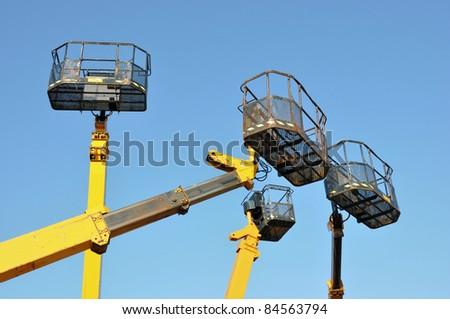 Four mobile platforms elevated towards a blue sky - stock photo