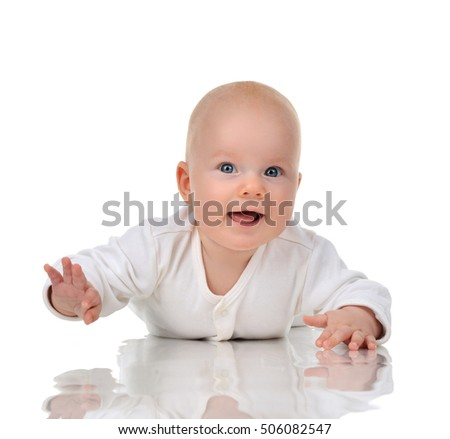 Four month Infant child baby girl lying on a floor happy smiling isolated on a white background