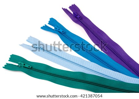 Four multi-colored zipper isolated on white background