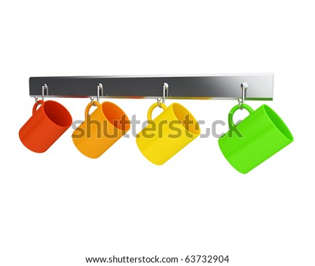 four multicolored mugs hang - stock photo