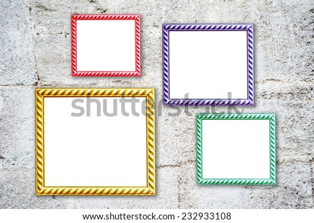 Four multicolored photo frames on the retro wall - stock photo