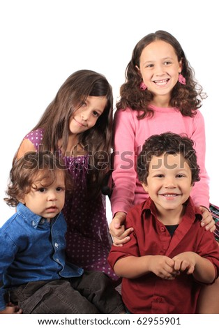 Four multiracial children consisting of two boys and two girls, brothers and sisters portrait on a white background - stock photo