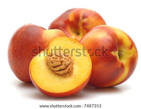four  nectarines on white background - stock photo