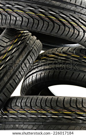Four new black tires isolated on white background - stock photo