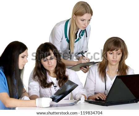 Four nice young doctors on a white - stock photo