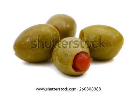four olives on white background