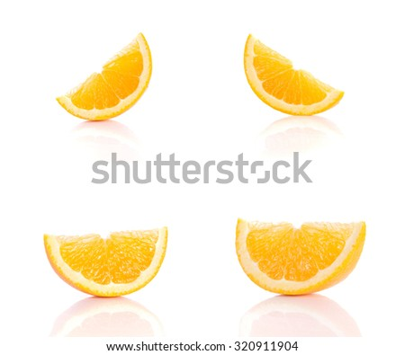 Four oranges cut on white background.