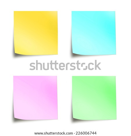 Four pastel colored sticky notes isolated on white background - stock photo