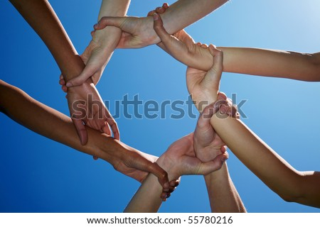 Four people holding each other on the wrists