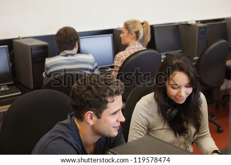 Four people in college computer class