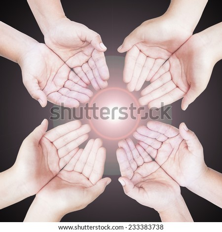 Four people open empty hands with palms up over amazing light background. World Mental Health Day concept. International Volunteers Day, International Human Solidarity Day concept. - stock photo