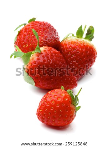 Four Perfect Ripe Strawberries isolated on white background. Focus on Foreground - stock photo