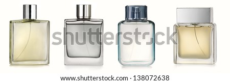Four perfume spray bottles - stock photo