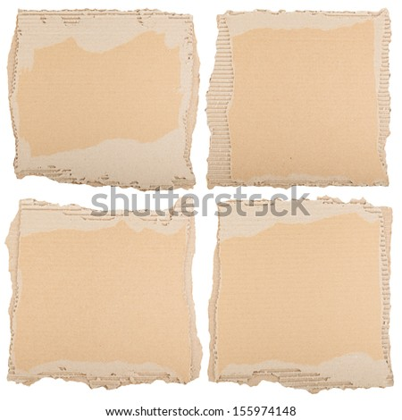 Four pieces of brown cardboard. Can be used as grunge background. - stock photo