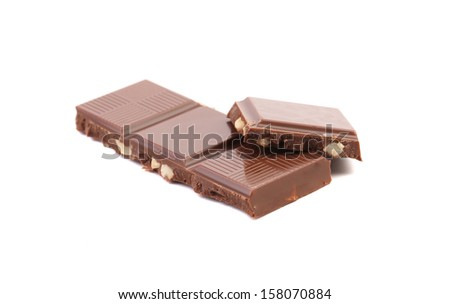Four pieces of chocolate. Isolated on a white background.