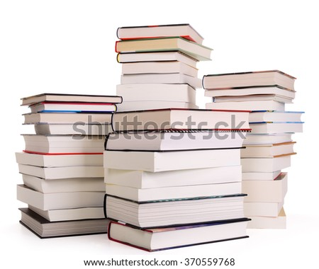 Four piles of books isolated on white. Contains clipping path.