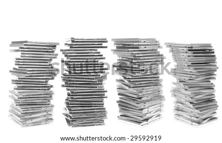 Four piles of disc cases. Isolated on white. White space at the top. - stock photo