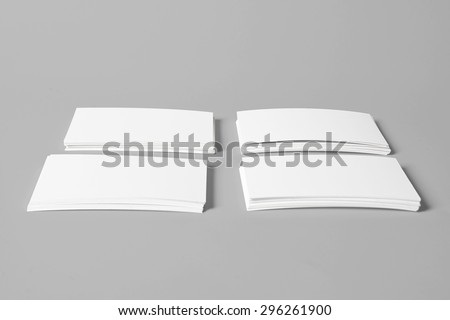 Four Piles of White Horizontal Business Cards with Clipping Path On Grey Background