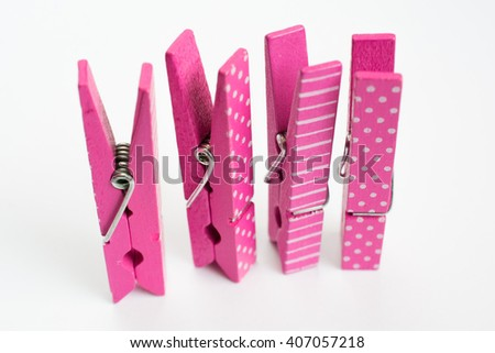 Four Pink Clothes Pins with Fun Patterns Standing Up Angled Front View