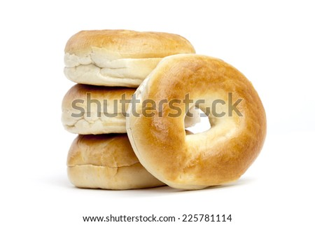 Four plain bagels on white background - stock photo
