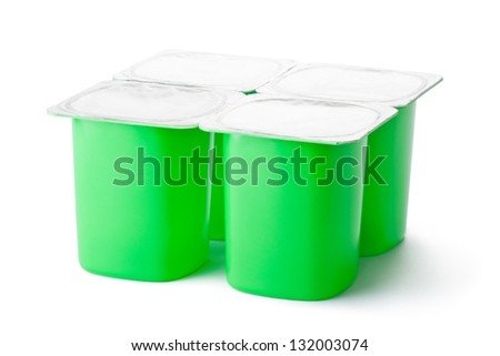 Four plastic containers for dairy products with foil lid. Isolated on a white. - stock photo