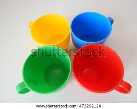four plastic cups on a white background
