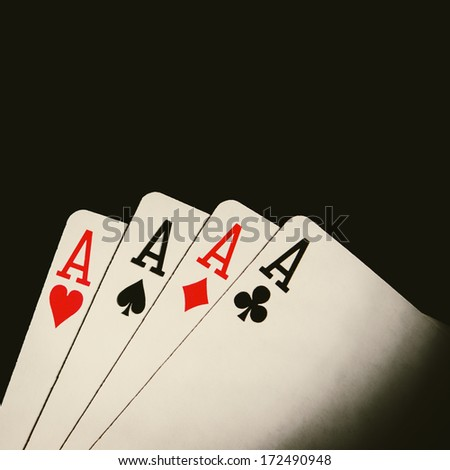 four poker cards on background