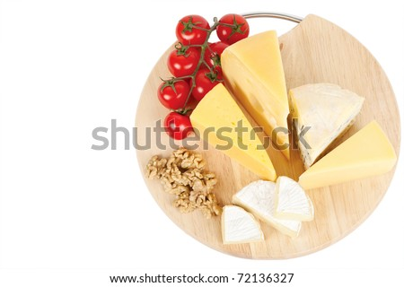 Four popular kinds of cheese ,tomatoes and walnut on a white background. A shot horizontal, focus in the shot foreground.d. - stock photo