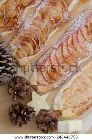 Four powdered apple puffs with cinnamon and sugar - stock photo