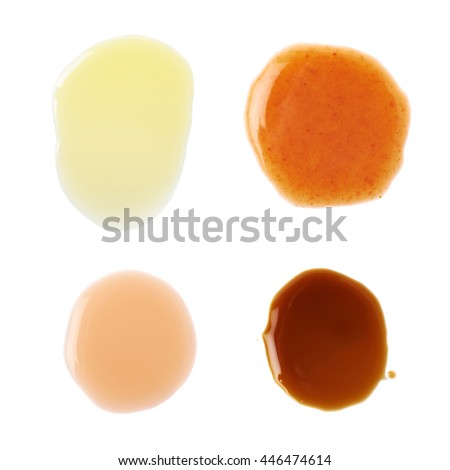 Four puddles of hot pepper, worchester sauce, olive oil and wine vinegar, isolated over the white background - stock photo