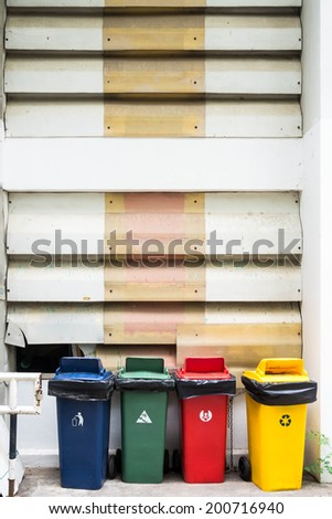 four recycling bins various color - stock photo