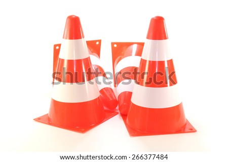 four red and white pylons on a bright background - stock photo
