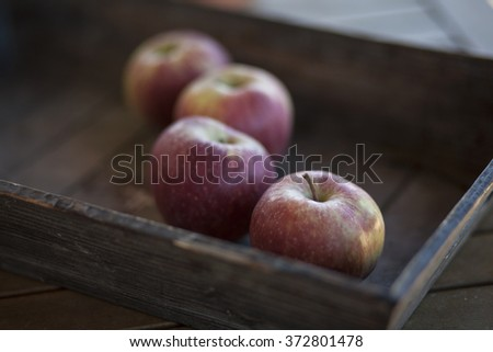 four red apples with focus on the first one - stock photo