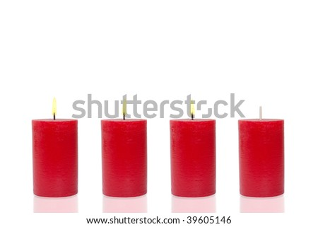 Four red candles, three burn - stock photo