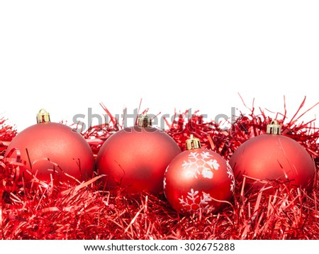 four red Christmas baubles and tinsel isolated on white background - stock photo