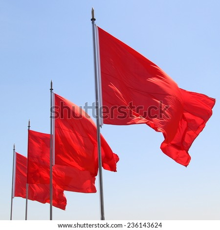 Four red flags in China (Tiananmen Square) - stock photo
