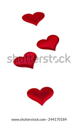 four red hearts Valentine's Day symbols on a white background closeup - stock photo