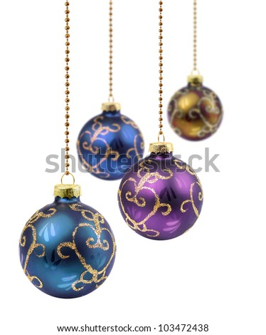 Four retro color Christmas balls hanging on white background isolated - stock photo