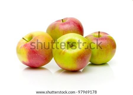 four ripe apple on a white background close-up - stock photo