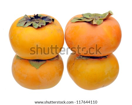 four ripe persimmon isolated on white background